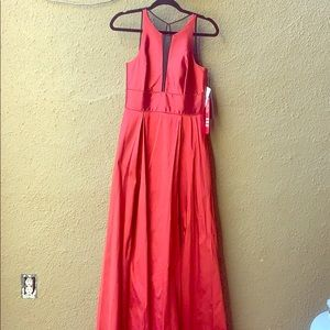 sleeveless ruby gown with mesh accents